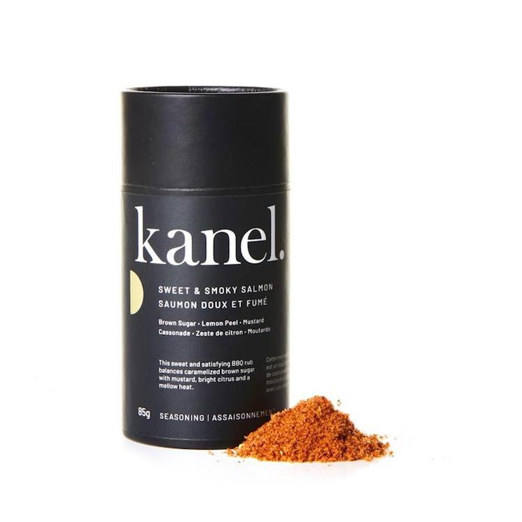 Sweet & Smoky Rub in a black cardboard tube surrounded by a blend of brown sugar, sea salt, chili, garlic and lemon peel