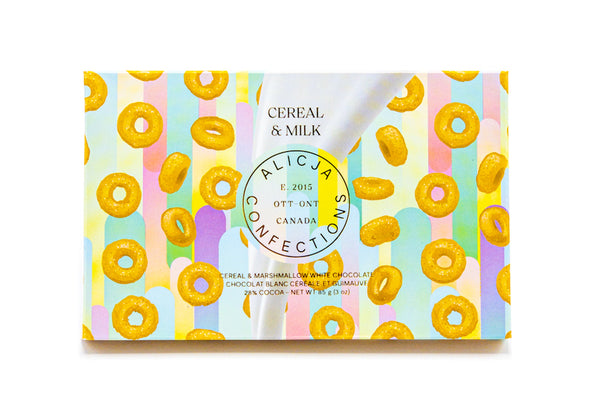 Cereal & Milk bar package showing milk being poured on cheerios on a pastel rainbow background
