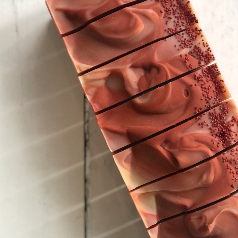 Small batch cherry almond soap stacked on top of each other