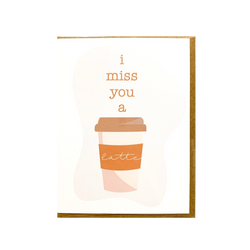 "A 4.25"" x 5.5""  matte white card with ""I miss you a latte"" over top a picture of a latte laying on top of a kraft envelope incased in a cellophane sleeve"