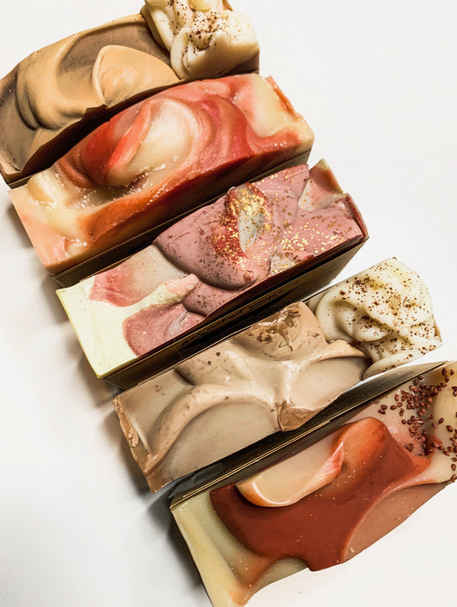 Apple pie, pumpkin spice, sweater weather, sugar plum and cherry almond soaps side-by-side