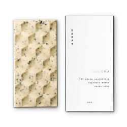 A geometric caramelized white chocolate bar with real Italian espresso laying side-by-side next to a white and silver Mocha bar box