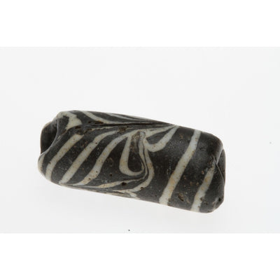 Early Islamic Black Tube Bead with White Trailing, Middle East
