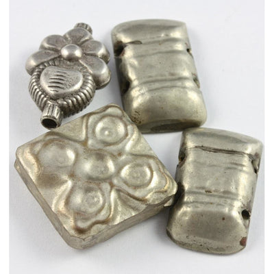 Rectangular, square and flowered hollow Bedouin silver pendants, group of 4, old