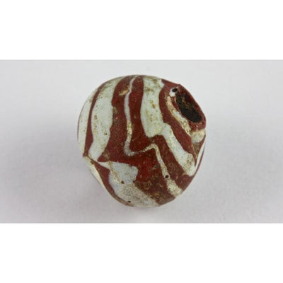 Early Islamic Red Glass Bead with White Trails, Middle East