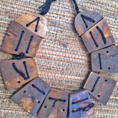 Carved Wooden Buddhist Flat 4-Holed Beads, Strand, Nepal - Rita Okrent Collection (ANT117)