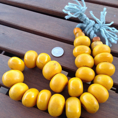 Strand of Large Yellow Orange Moroccan Faux Amber Beads - NP034