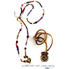 Lariat necklace, made of collection of African Trade beads and brass ends