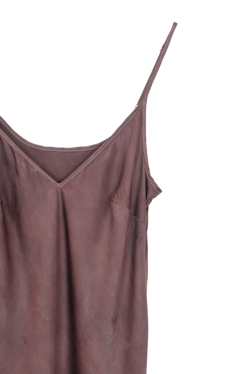 front detail of silk midi slip dress in a muted berry brown color
