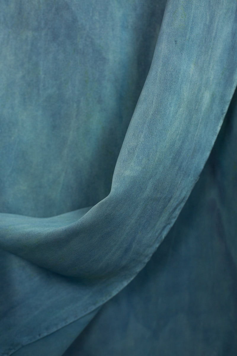 draped fabric of large silk square in aquamarine blue green
