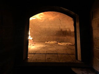 Fire-burning pizza oven at Filaga da Giacomino
