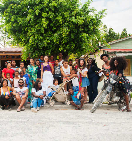 Group picture of the crew working in the village Juanillo in the Dominican Republic, where they the Baile de Colores resort wear 19 campaign
