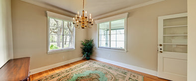 Wide panorama of unfurnished dining room with windows
