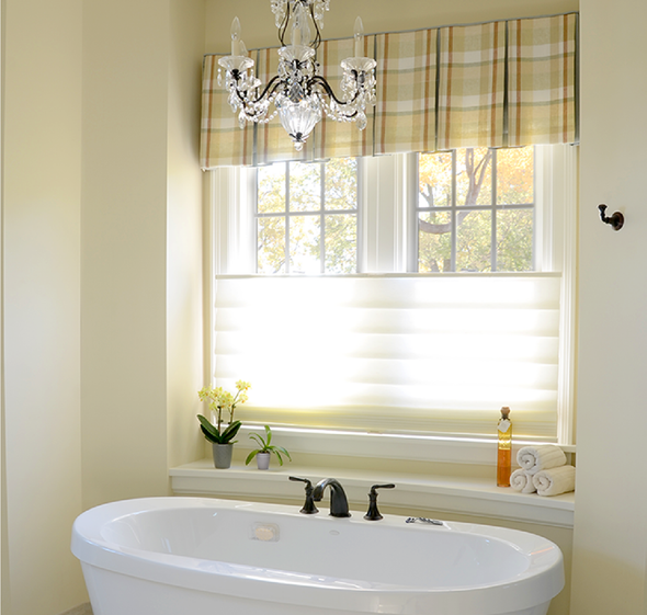 Window grilles installed in bathroom windows.