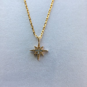 Gold star necklace with CZ
