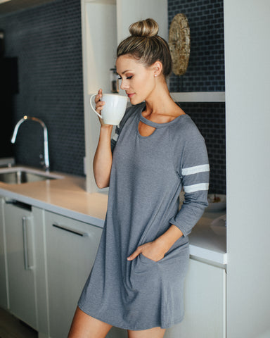 woman enjoying coffee in her kitchen