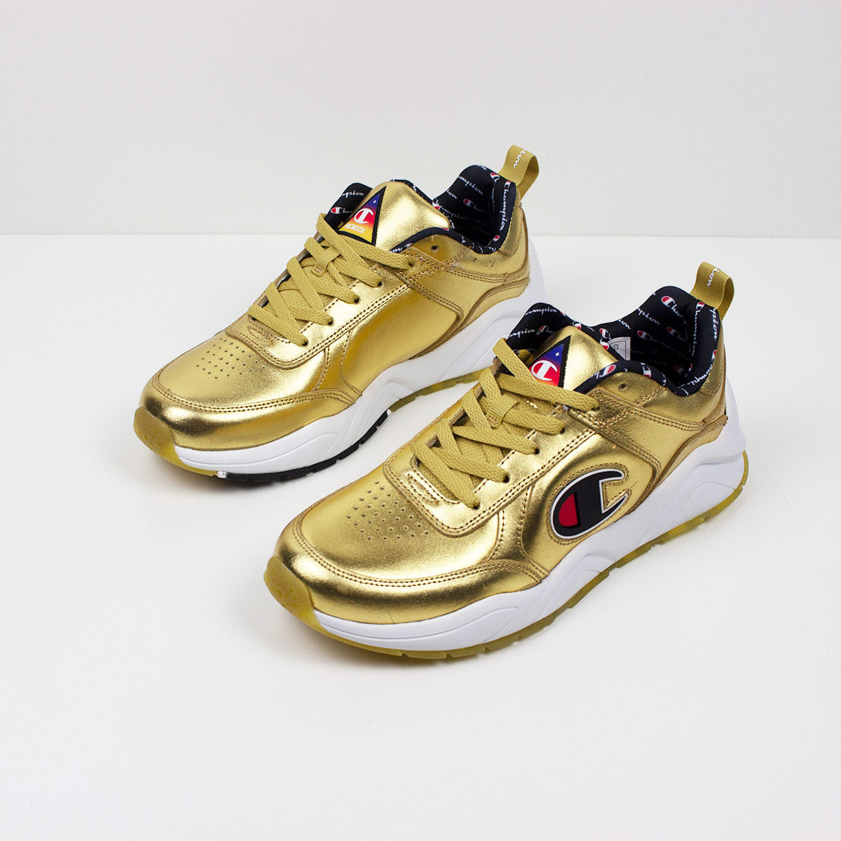 fc34f444d09 Champion 93 Eighteen Metallic Gold Sneakers - PremierVII. Champion