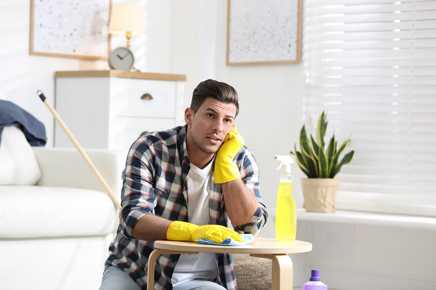 man procrastinating while cleaning