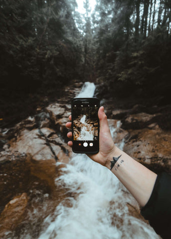 looking at nature through a phone educated earthling