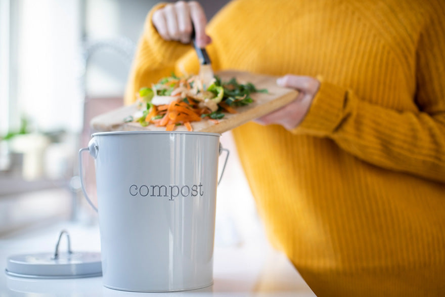 woman making compost