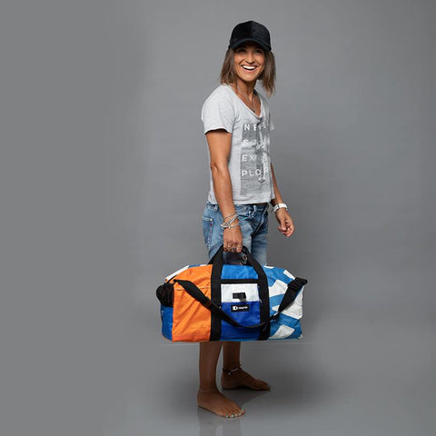 An upcycled KitePride stylish, handmade in Tel Aviv Duffle Backpack designed to fill your everyday needs with a social and environmental impact.