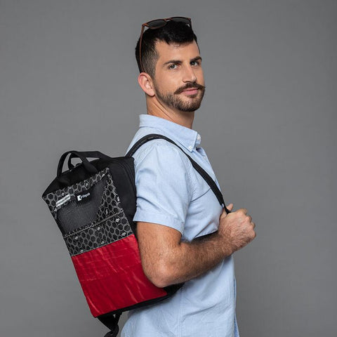 An upcycled KitePride stylish, handmade in Tel Aviv Laptop Backpack designed to fill your everyday needs with a social and environmental impact.