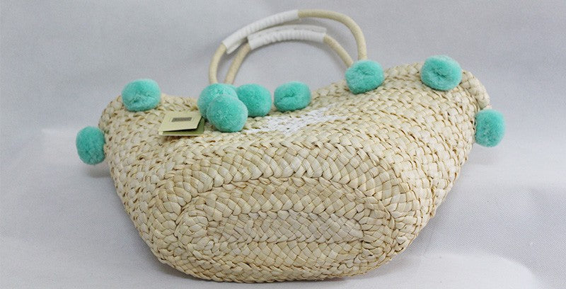 woven beach bag with tassels