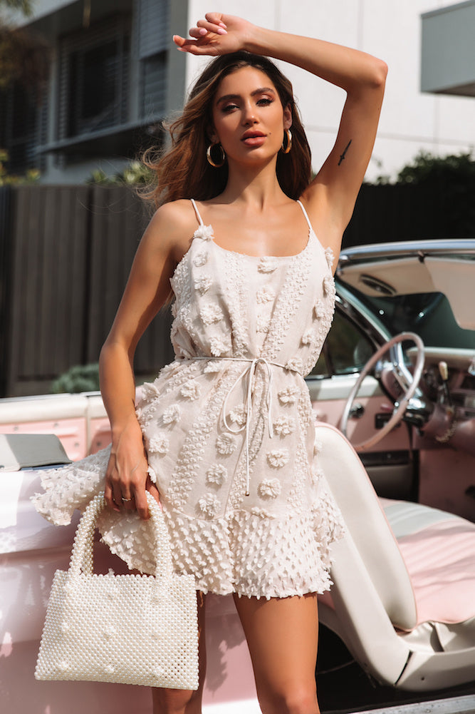 beige textured pom pom dress