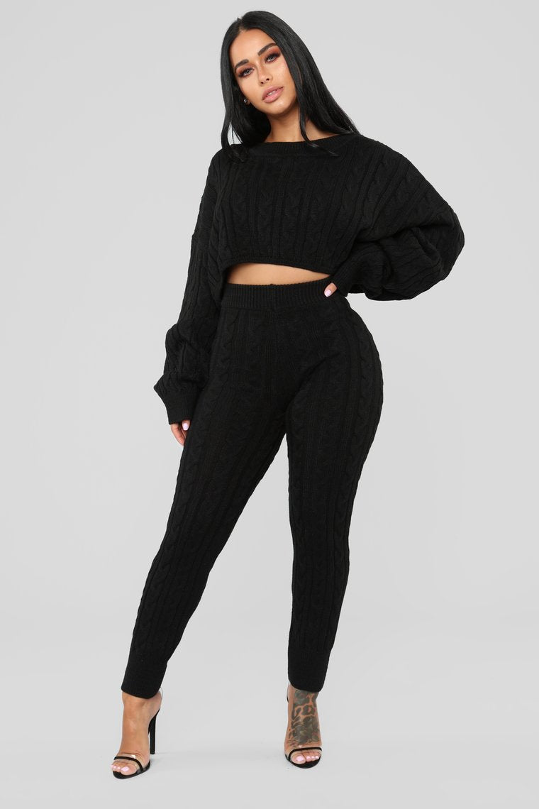 black batwing sweater and cable knit leggings set