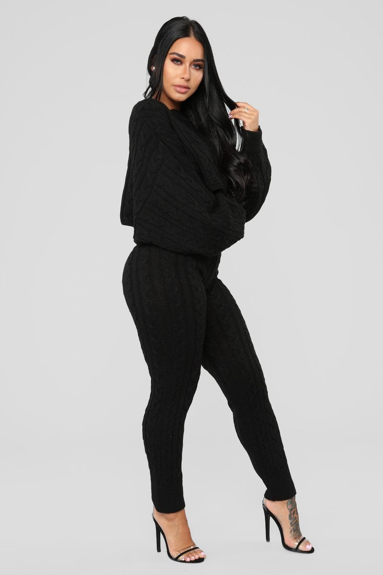 black batwing sweater and knit leggings co-ord set
