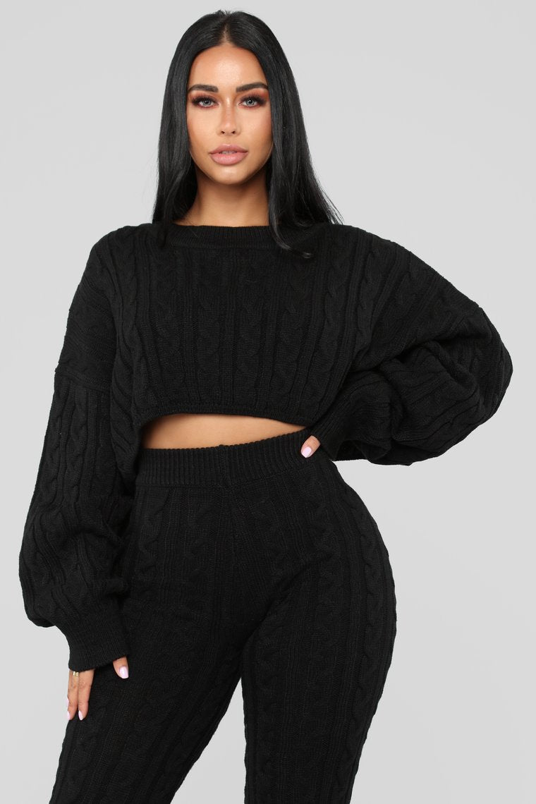 black batwing sweater and knit leggings set