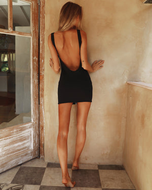 black zip front open back mini dress