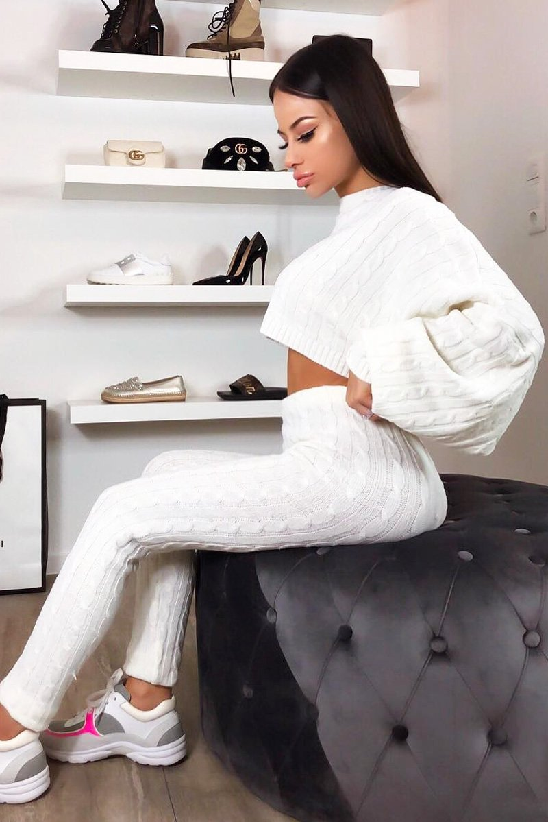 white batwing jumper and knit leggings set