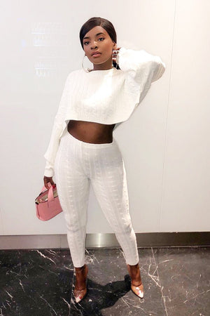 white batwing sweater and knit leggings co-ord set