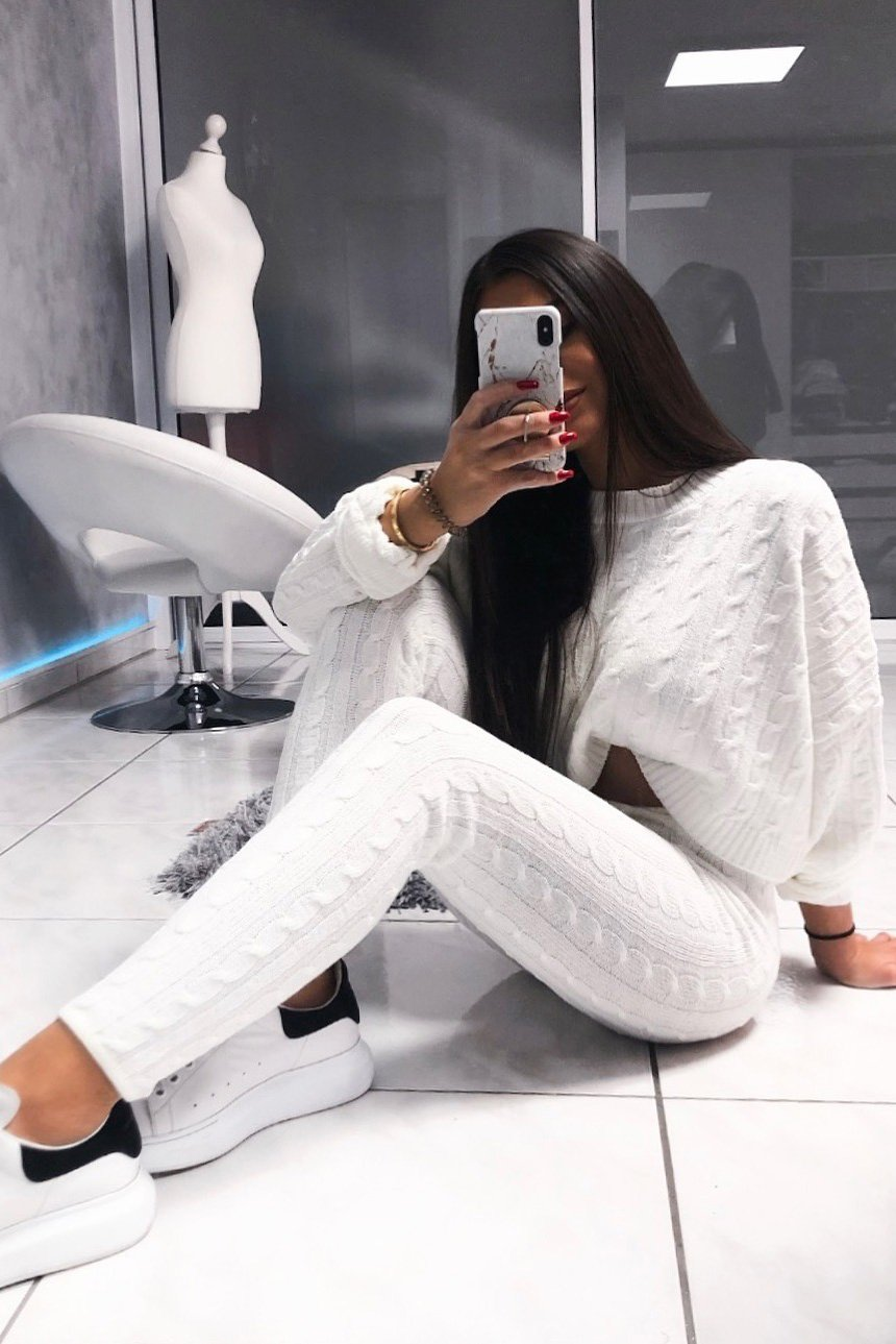 white batwing sweater and knit leggings set