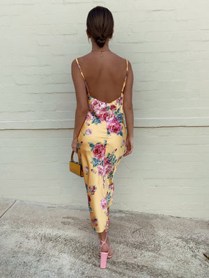 yellow open back midi dress