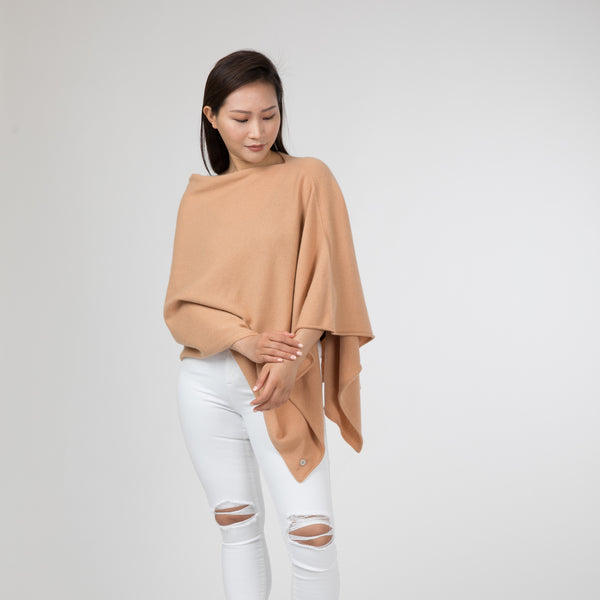 Poncho Classic This casual semi-fitted poncho can be used instead of a cardigan, jacket or a travel wrap. Our cashmere poncho is easy to tuck away in your handbag and ready for any occasion. A must in every wardrobe. Made from gorgeously soft cashmere. Hong Kong Stockholm Sweden