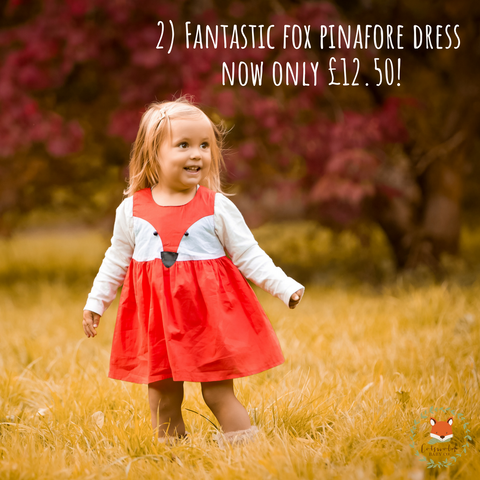 little girl wearing fox pinafore dress from cotswold baby co