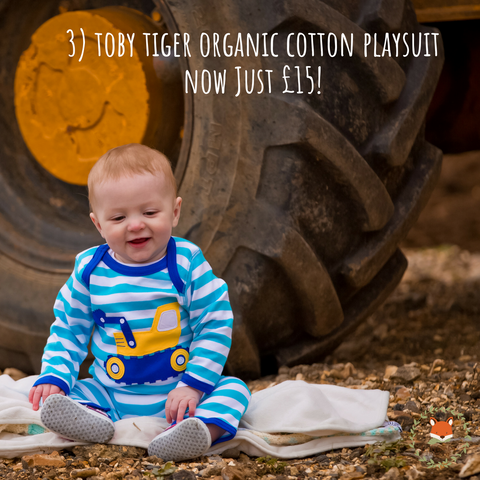 baby wearing toby tiger organic cotton digger playsuit - cotswold baby co