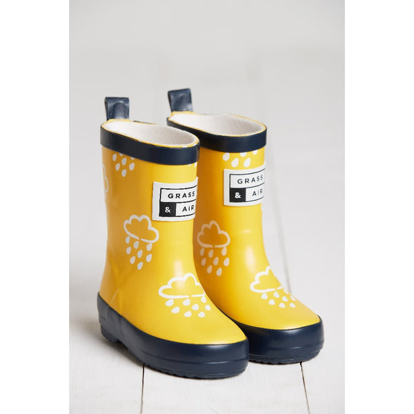 yellow colour changing wellies by grass and air - cotswold baby co
