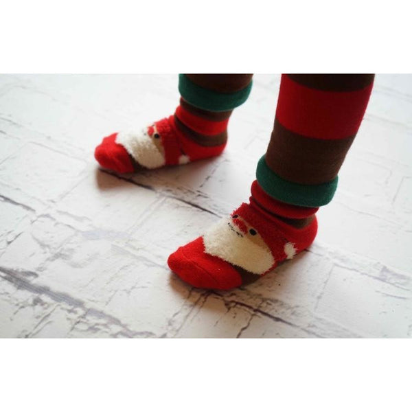 toddler wearing fluffy father Christmas  socks by Blade & Rose - Cotswold Baby Co