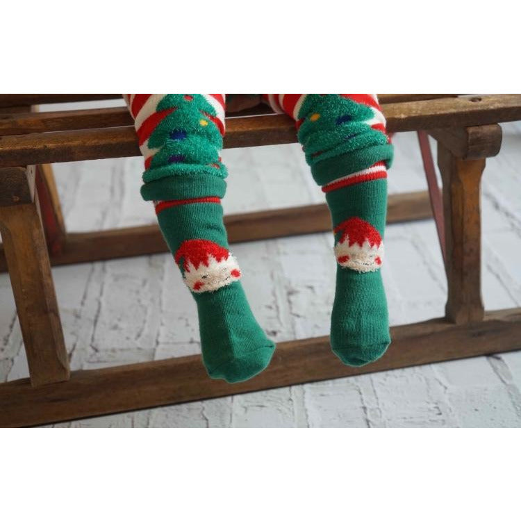 toddler wearing fluffy elf socks by Blade & Rose - Cotswold Baby Co