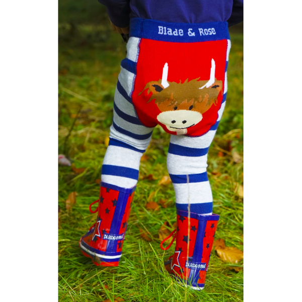 Child wearing Highland Cow leggings by Blade & Rose