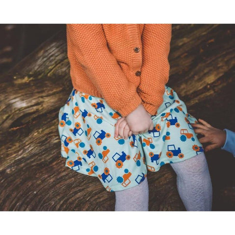 little girl wearing Aqua Blue Tractor Skirt by Toucan Blue | Cotswold Baby Co