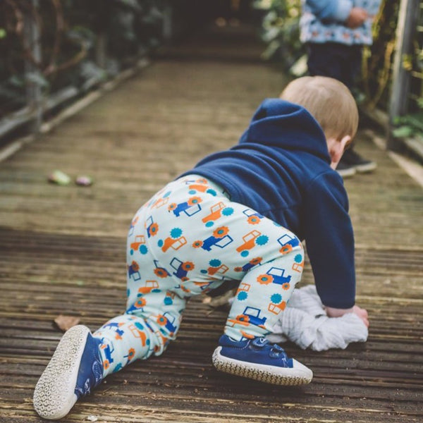 toddler wearing aqua cuffed tractor leggings | Cotswold Baby Co