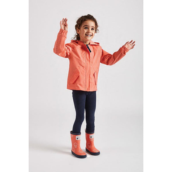 Girl wearing coral rain cheater waterproof coat by Grass and Air - Cotswold Baby Co
