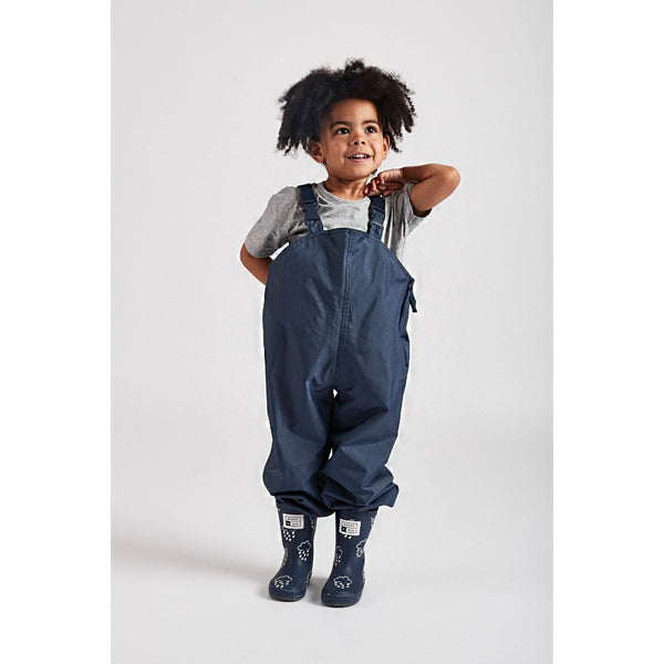 little boy wearing Navy stomper slacks by Grass & Air - Cotswold Baby Co