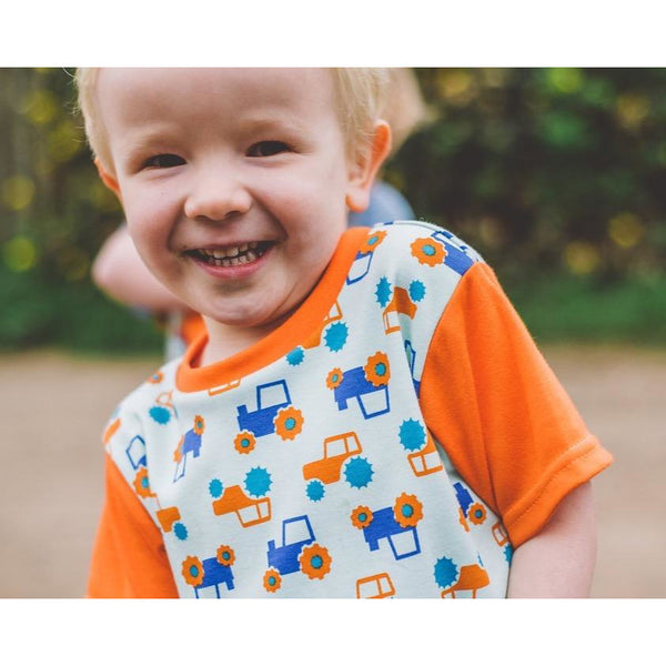 Little Boy wearing Orange & Aqua Tractor T-shirt by Toucan Blue | Cotswold Baby co
