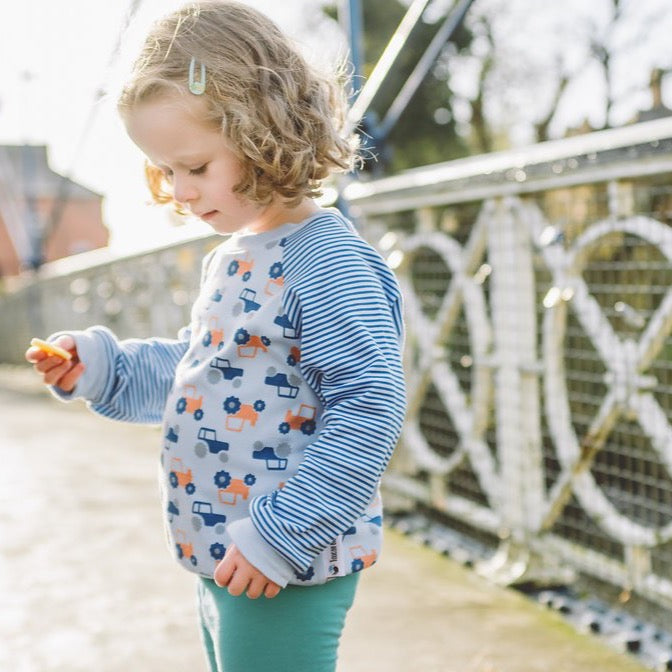 little girl wearing Tractor Sweatshirt from Toucan Blue | Cotswold Baby Co