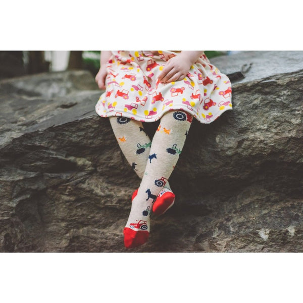 little girl wearing Farmyard Tights | Cotswold Baby Co